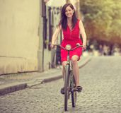Beautiful brunette girl on a vintage bike Royalty Free Stock Photos