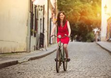 Beautiful brunette girl on a vintage bike Royalty Free Stock Images
