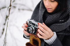 Beautiful brunette girl with a vintage camera Royalty Free Stock Photography