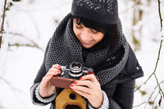 Beautiful brunette girl with a vintage camera royalty free stock photo