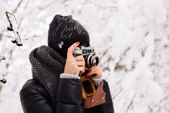 Beautiful brunette girl with a vintage camera Royalty Free Stock Photos