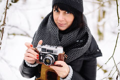 Beautiful brunette girl with a vintage camera Stock Photo