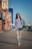 Beautiful brunette girl walks through the city Royalty Free Stock Image