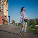 Beautiful brunette girl walks through the city Stock Images