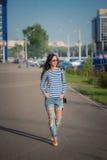 Beautiful brunette girl walks through the city Stock Photography