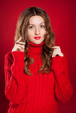 Beautiful brunette girl wearing red sweater Royalty Free Stock Photography