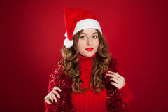 Beautiful brunette girl wearing Santa Clause hat Royalty Free Stock Image