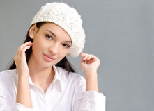 Chic girl wearing a beret. Beautiful  brunette girl wearing a white beret. Student relaxing Royalty Free Stock Photography