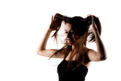 Beautiful brunette girl with windy hair. Brunette girl with windy hair posing against white background Royalty Free Stock Photos