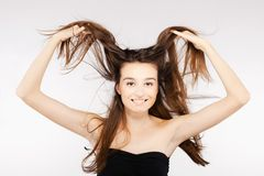 Beautiful brunette girl with windy hair. Brunette girl with windy hair looking at camera Stock Photography