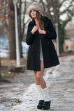 Beautiful brunette girl in winter clothes outdoor Stock Image