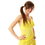 Beautiful brunette girl in yellow dress. Royalty Free Stock Photo