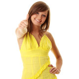 Beautiful brunette girl in yellow dress. Isolated on white background Royalty Free Stock Photography