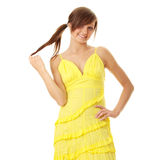 Beautiful brunette girl in yellow dress Stock Images