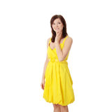 Beautiful brunette girl in yellow dress. Stock Photos