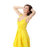 Beautiful brunette girl in yellow dress. Royalty Free Stock Image