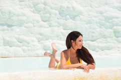 Beautiful brunette girl in yellow swimsuit in pamukkale. Province of Denizli in the south-west of Turkey. Beautiful brunette girl in yellow swimsuit in Stock Photos