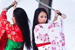 Beautiful brunette girls in a japanese kimono Royalty Free Stock Images