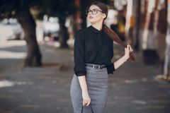 Beautiful brunette with glasses Royalty Free Stock Photos