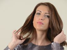 Beautiful brunette in glittering dress Stock Photography