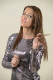 Beautiful brunette in glittering dress Stock Image