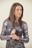 Beautiful brunette in glittering dress stock photos