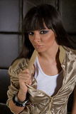 Beautiful brunette in a golden jacket Stock Photo