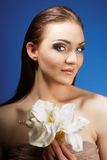 Beautiful brunette with gorgeous hair. flower Royalty Free Stock Photos