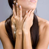 Beautiful brunette grase a neck Stock Image
