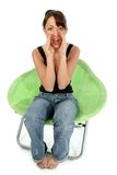 Beautiful Brunette in Green Chair royalty free stock photography