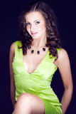 Beautiful brunette in green dress Stock Photos