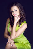 Beautiful brunette in green dress Stock Image