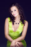 Beautiful brunette in green dress Royalty Free Stock Images