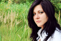 Beautiful brunette in a green lea royalty free stock photos