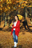 Beautiful brunette guitar player girl in the forest Royalty Free Stock Photos