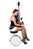 Beautiful brunette with a guitars and snare drum Royalty Free Stock Photography