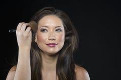 Beautiful Brunette Hair Model has makeup applied stock photo