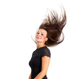 Beautiful brunette hair motion freeze. Isolated over white Royalty Free Stock Image