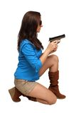 Beautiful Brunette with a Handgun Royalty Free Stock Photos
