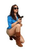 Beautiful Brunette with a Handgun Royalty Free Stock Images