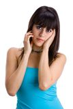 Beautiful brunette with hands on head Royalty Free Stock Photo