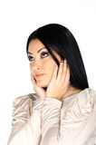 Beautiful brunette with hands to her face Royalty Free Stock Photography