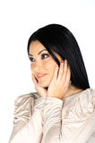 Beautiful brunette with hands to her face Stock Photos