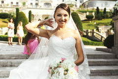 Beautiful brunette happy bride in white dress. Posing on stone st Stock Photography