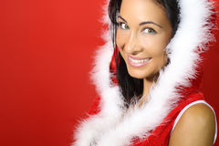 Beautiful brunette happy for christmas. With a red background royalty free stock photography