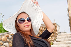 Beautiful brunette with hat Stock Images