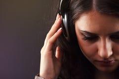 Beautiful brunette in headphones Stock Image