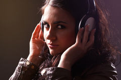 Beautiful brunette in headphones Royalty Free Stock Image