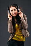 Beautiful brunette in headphones Royalty Free Stock Photo