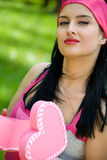 Beautiful brunette with heart shaped gift box Stock Images